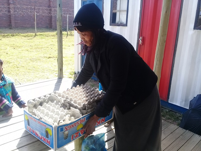 Distributing recycled material for activities at Grahamstown local schools.