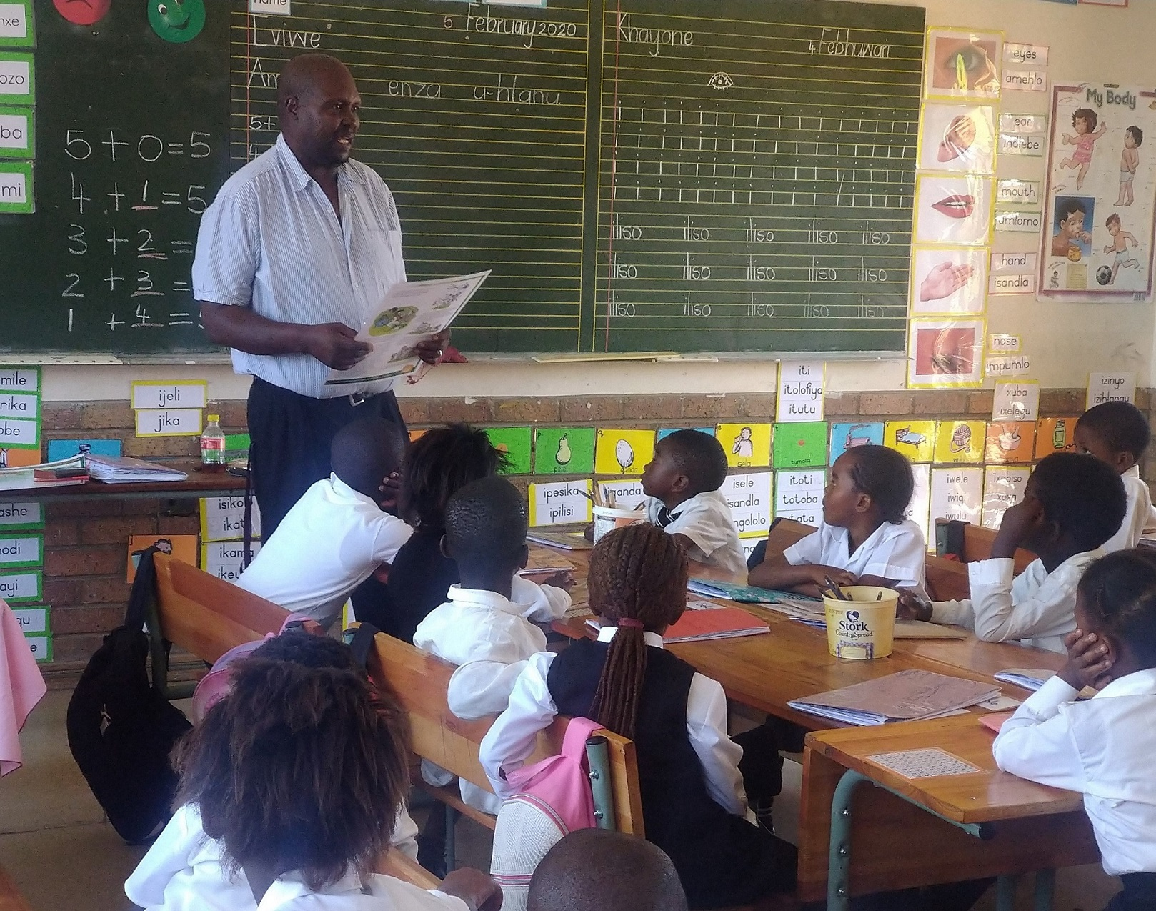 Thuso Moss reading to learners on World Read Aloud Day.