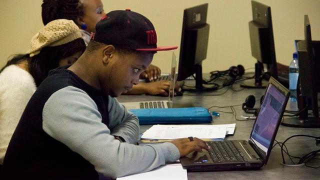 A student works on his laptop during the social media bootcamp at Rhodes JMS