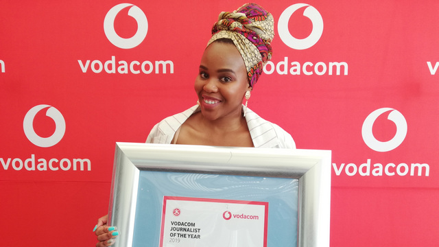 School of Journalism alumna, Andiswa Matikinca, proudly displaying her regional Young Journalist of the Year award.