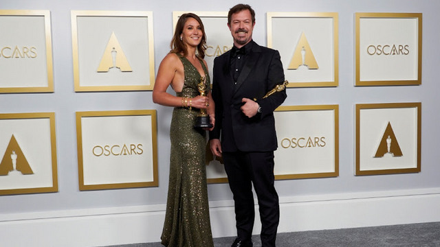 Rhodes University alumnus, Pippa Ehrlich and co-director James Reed pose in the press room with the award for Best Documentary Feature for 'My Octopus Teacher' at the Oscars, in Los Angeles, the US, on April 25.  Picture: REUTERS/CHRIS PIZZELLO