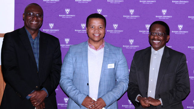 Awardees stand with the VC at the award ceremony