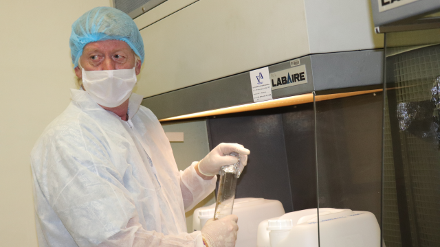 Professor Rod Walker manufacturing sanitiser in the Pharmacy lab