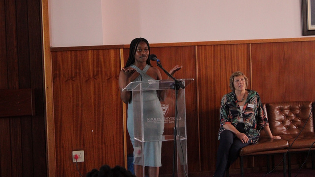3rd year Accounting student, Zintle Nonqayi speaking during the launch, whole Professor Jackie Arendse looks on