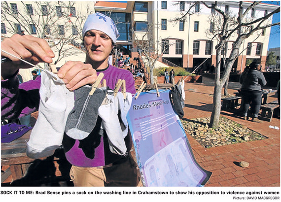 GENDER violence came under the spotlight in Grahamstown yesterday when Rhodes University men stepped up to voice their disapproval. They signed pledges and pegged old mismatched socks on a specially erected campus washing line.