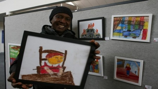 Dotun Makun with one of the artworks